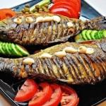 Рыба, фаршированная грибами, в духовке